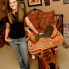 Barrel Racer Whitney Gibson stands next to a saddle she has won Friday, July 1, 2007 at her home in Kilgore.  (Kevin Green/News-Journal Photo)