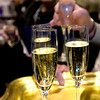 Flutes of champagne are offered to guests attending the opening night fundraiser of the Zonta Club of Longview's 33rd annual Antiques Show and Sale at Maude Cobb, on Thursday, March 1, 2007. The show will continue through Sunday at Maude Cobb. (Luisa Morenilla/Longview News-Journal)