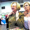 From left, Linda Killough and Angele Fanning examine themselves in a mirror with pieces of vintage jewelery for sale at the Zonta Antique Show at Maude Cobb on Friday, March 2, 2007.  (Luisa Morenilla/Longview News-Journal)