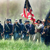 Union troops march through the smoak on to the battle field Sunday May 6, 2007, during the reenactment of the Battle Of Port Jefferson. (Michael Cavazos/News-Journal Photo)