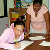 East Texas Literacy Council math instructor Ayanna Merchant, standing  LaKesia Hodge, right, Wednesday, October 3, 2007 at the center in Longview. Submitted Photo