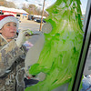 Tammy Hill, of Diana paints on the windows at Longview Wheel and Performance Monday, December 1, 2008 on West Marshall Ave in Longview.   (Kevin Green/News-Journal Photo)