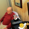 Leon Mills talks about WWII as a 50 calibur bullet hangs in his home Monday, December 1, 2008 in Longview.  (Kevin Green/News-Journal Photo)