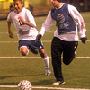 Zach Gomez tries to get the ball from Pine Tree Alum Dustin Riggs during Wednesday nights Pine Tree Alumni Soccer game at Pine Tree Stadium. (Jacob Croft Botter/News-Journal Photo)