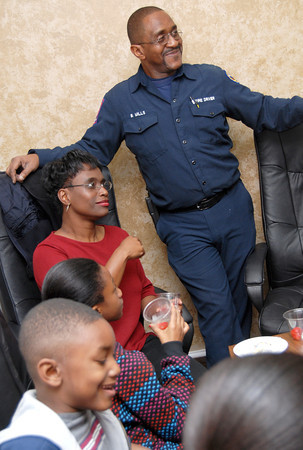 Byron Mills, his wife Carlette, and there children enjoy some cake and punch at a reception marking his retirement on Wednesday at the Central Fire Station in Longview. (Jacob Croft Botter/News-Journal Photo)