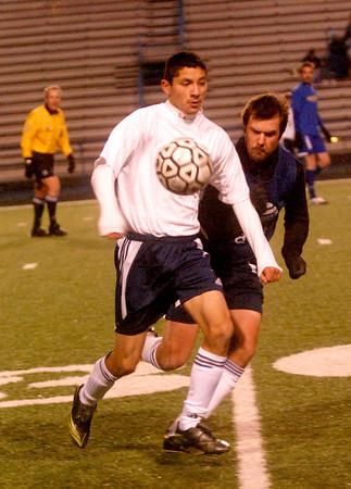 Carlos Ponce works the ball past Pine Tree Alum Dustin Bates during Wednesday nights Pine Tree Alumni Soccer game at Pine Tree Stadium.(Jacob Croft Botter/News-Journal Photo)