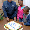 Byron Mills, cuts the first piece of cake with two his children Rebekah and Robert at a reception marking his retirement on Wednesday at the Central Fire Station in Longview. (Jacob Croft Botter/News-Journal Photo)