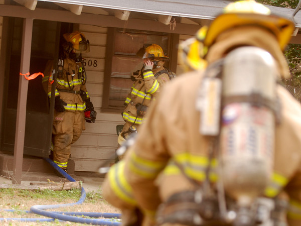 Longview firefighters works to put out a fire that occured Thursday at 608  Harrell St. in Longview. (Jacob Croft Botter/News-Journal Photo)