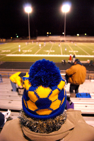 Roxanne Allenbundeled up Wednesday night to watch the Pine Tree Alumni soccer game at Pine Tree Stadium.(Jacob Croft Botter/News-Journal Photo)