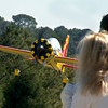 Spectators watch as a plane piloted by Eddie Bernaldez makes a landing at the club's Fun Fly fundraiser to collect toys and donations for Toys for Tots Saturday, November 8, 2008. (Les Hassell/News-Journal Photo)