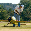 Eddie Bernaldez, vice president of the East Texas Aeromodelers, prepares his plane for take off at the club's Fun Fly fundraiser to collect toys and donations for Toys for Tots Saturday, November 8, 2008. (Les Hassell/News-Journal Photo)