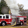 Longview firefighters battle a large blaze Friday at what officials believe was a vacant home.<br /> Nobody was injured in the fire, which started around 2:30 p.m. Friday at 1614 E. Cotton St., near the intersection of 14th Street.<br /> The block was cordoned off as firefighters doused the flames.<br /> Investigator Joey Cowan with the Longview Fire Marshal's office said he did not think anyone lived at the residence, a one-story, wood-frame home.<br /> Nobody was at the scene when emergency officials arrived, and the residence didn't have any utilities connected to it, Cowan said.<br /> It took firefighters about 15 minutes to subdue the flames, which left the back quarter of the home a charred frame.<br /> (Maggie Souza/News-Journal Photo)