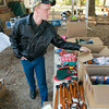 Larry Barnett shows new  items for sale at their garage sale Friday, November 21, 2008 of St. Clair in Longview.  (Kevin Green/News-Journal Photo)