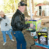 Larry Barnett and his mom Donna Barnett, left, rearrange items at their garage sale Friday, November 21, 2008 of St. Clair in Longview.  (Kevin Green/News-Journal Photo)