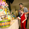 Hope Hays, 7, looks at Easter baskets with her mother Kay, right, and her Grandmother Tina McLane Wednesday, April 1, 2009 at Good Shepherd Medical Center. The baskets, made by emplyees, are being auctioned to raise money for Good Shepherd's Care and Share Fund. (Les Hassell/News-Journal Photo)