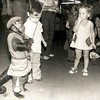 Morgan Layton, center, and Courtney Litchford, right, don't quite know what to think of Roy Roberts' monkey Sammy, as the well-dressed animal makes his way through the crowd of fairgoers at the 1980 Gregg County Fair, collecting money as he goes. (Rick Campbell/News-Journal File Photo)