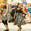 Hanah Dunn and Taylor Hernden participate in a girl scout style show at Kohl's on Saturday August 1, 2009. (Michael Cavazos/News-Journal Photo)
