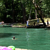 Children take a chance on the rope swing over the cool water at Camp Tonkawa Springs near Nacogdoches. The springs is a swimming hole straight out of Central Texas, nestled in the Piney Woods about 60 miles south of Longview.<br /> (scott from video)