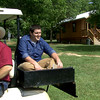 News-Journal reporter Wes Ferguson sits on the back of Sid Greer's golf cart while getting a tour around Greer Farms west of Daingerfield. Greer Farms, owned by Sid and his wife Eva, offers visitors a place to collect eggs, pick berries, fish learn the cullinary arts and more.<br /> (scott from video)