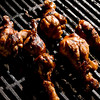 Grilling chicken. (Michael Cavazos/News-Journal Photo)