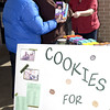 Bonnie Beverly, of Canton, buys Girl Scout cookies from Scout Erin Slaugther, 14, and her mom Rosalyn Slaughter on Sunday, March 1, 2009, in front of Kroger on Spur 63. (Justin Baker/News-Journal Photo)