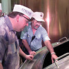 Casey Langbreoek, left a counselor(politician) and Harry Mertin, middle, a business man, both of the District of Chilliwack, listen to Wayne Crawford a asst. master brewer, as they look into a 750 bbls kettle, during a tour at Stroh's Brewery in Longview Thursday afternoon. Kevin Green