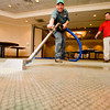 Robert LaMay of Servepro of Longview watches Clemente Rubio as he vacuums flood water out of Pinecrest Counrty Club on Tuesday September 1, 2009. (Michael Cavazos/News-Journal Photo)