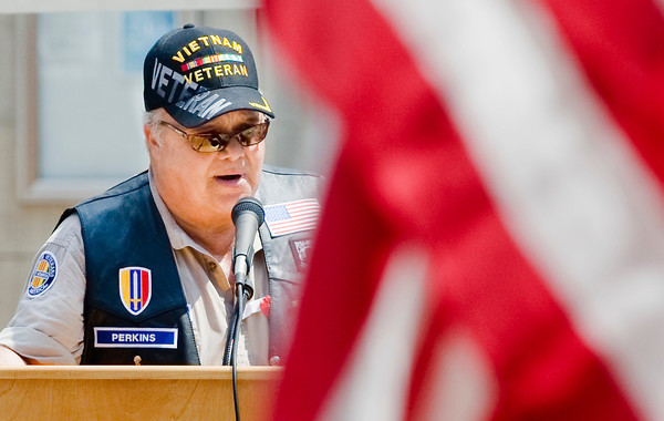 William Perkins, commander of VFW Post 1183 and President of the Viatnam Veterans of America Longview Chapter 987, speaks during the Gregg County Memorial Day Service, on Monday May 31, 2010, at the Gregg County Courthouse. (Michael Cavazos/News-Journal Photo)