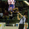 A referee tries to get Globetrotter Bull Bullard off of the goal so the game can start Sunday, January 31, 2010 at Longview High School's Lobo Colisuem. (Justin Baker/News-Journal Photo)