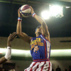 Globetrotter Prince Perez goes up for a dunk in a game against the Washington Generals Sunday, January 31, 2010 at Longview High School's Lobo Colisuem. (Justin Baker/News-Journal Photo)