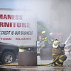 Firefighters battle a blaze at Maness Funiture in downtown Kilgore Wednesday, June 30, 2010. (Les Hassell/News-Journal Photo)
