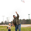 Robert Francis and his son Cody, 3, fly a kite Saturday, Dec. 31, 2011 at Lear Park. (Les Hassell/News-Journal Photo)