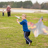 David Francis, 5, tries to get a kite airborn Saturday, Dec. 31, 2011 while spending the afternoon with his family at Lear Park. (Les Hassell/News-Journal Photo)