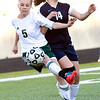 Longview's #5 and Pine Tree's Lorenza Gonzalez battle for control of the ball during Friday's Dec. 30, 2011 game. (Les Hassell/News-Journal Photo)