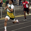 Lonjgview's Deinonte Wall pulls ahead of Kilgore's LaDarius Anthony in a relay during the Graham-Knowles Invitational Saturday at Pine Tree Stadium. (Justin Baker/News-Journal Photo)