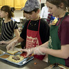 Volunteers Max Kelt and Bethany Mayfield serve lunch Sunday at HiWay 80 Rescue Mission. (Justin Baker/News-Journal Photo)