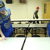 Volunteers from Alpine Church of Christ clean up after lunch Sunday at HiWay 80 Rescue Mission. (Justin Baker/News-Journal Photo)