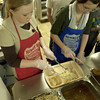 Volunteers Brooke pool, left, and Olivia Hughes serve lunch Sunday at HiWay 80 Rescue Mission. (Justin Baker/News-Journal Photo)