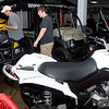Johnny, left, and Ethan Land look at ATVs Sunday at the 29th Annual Boat, RV and Camping Expo at the Longview Exhibit Building. (Justin Baker/News-Journal Photo)