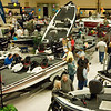 People look at boats on display Sunday at the 29th Annual Boat, RV and Camping Expo at Maude Cobb Convention and Activity Center. (Justin Baker/News-Journal Photo)
