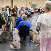 Owners and their dogs wait for their event to begin Sunday, July 31, 2011 at the Longview Kennel Club's All Breeds Show at the Maude Cobb Convention and Activity Center. (Les Hassell/News-Journal Photo)