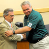 Longview ISD Athlectic Director Pat Collins, left shakes hands with head football John King, right, after annoucing his retirement during a press conference Thursday, June 30, 2011 at the LISD adminstration building in Longview. (Kevin Green/News-Journal Photo)