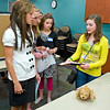 Sidney Lowell, 13, of Spring Hill describes her Rock 'N' Dog Walk invention to other students at the Contraption Challenge at the Region 7 Education Service Center Thursday, March 31, 2011. (Les Hassell/News-Journal Photo)