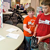 Seth Lassiter, 12, left, and Cade palmer, 13, both of White Oak, show off their Step Tracker invention at the Contraption Challenge at the Region 7 Education Service Center Thursday, March 31, 2011. (Les Hassell/News-Journal Photo)