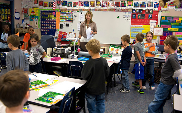 Michelle Malloy works with first-graders in her classrom at Spring Hill Primary Tuesday, Nov. 1, 2011. (Les Hassell/News-Journal Photo)