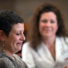 Nurse practitioner Monica White, right, listens as cancer survivor Kimberly Scherrer talks about her battle with breast cancer Tuesday, November 1, 2011 at Texas Oncology. (Les Hassell/News-Journal Photo)