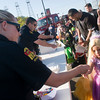 Kilgore Police Department officer Veronica Wheeler, left, passes out candy to Juliet Resendiz, right, of Kilgore as area youth participate in the trick-or-treat  Monday, Nov. 1, 2011, in downtown Kilgore. (Kevin Green/News-Journal Photo)