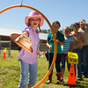 Tessa Morris, 8, tosses her hat through a ring during Western Days activities at Hallsville's North Elementary Friday, Sept. 30, 2011. (Les Hassell/News-Journal Photo)