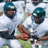 Longview High School football QB Bivins Caraway, left, fakes a hand off to tailback Tory White, right,  during drills at the first day of spring practice Monday, April 30, 2012, in Longview.  (Kevin Green/News-Journal Photo)