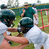Longview High School Head Coach John King encourages players during drills at the first day of spring practice Monday, April 30, 2012, in Longview.  (Kevin Green/News-Journal Photo)